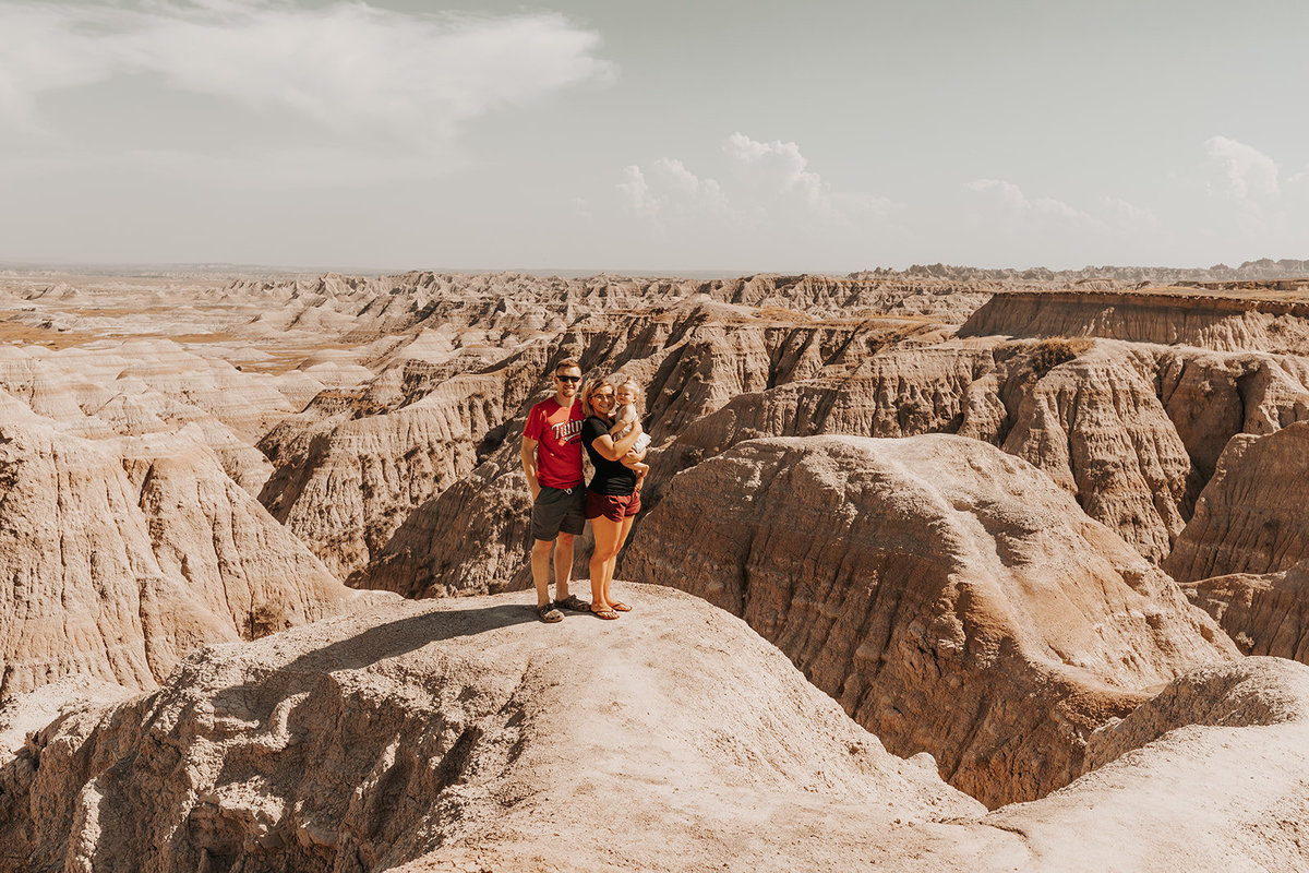 The family posing for a potrait in the badlands of south dakota
