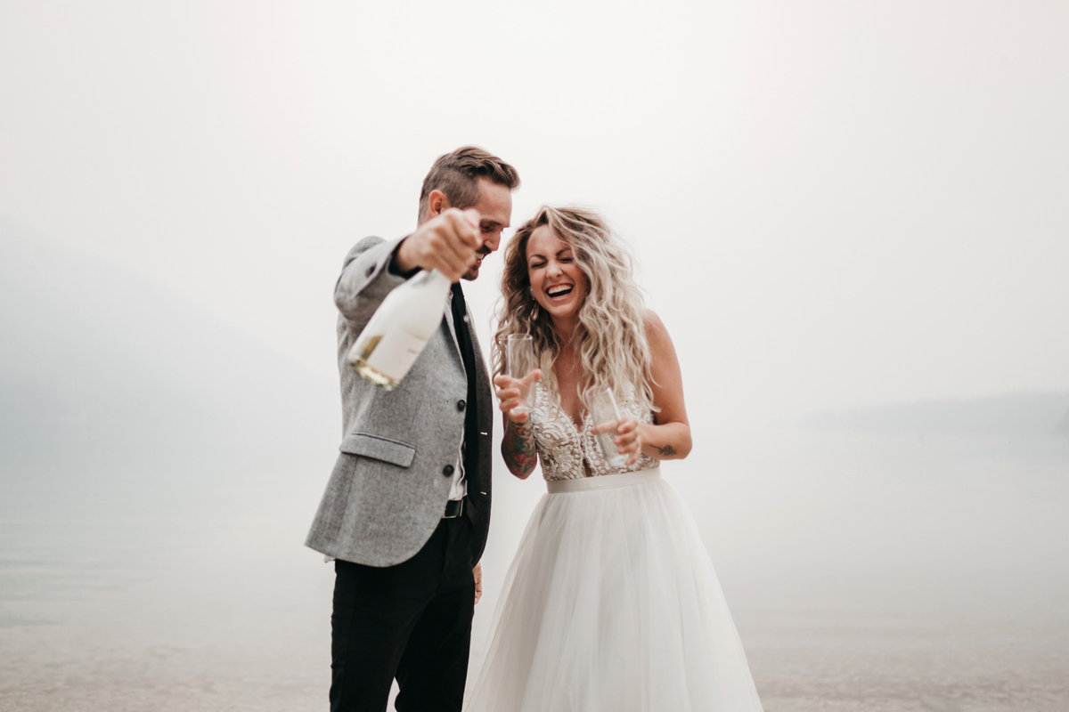 athena-and-camron-sara-truvelle-bridal-wenatchee-elopement-intimate-39-champagne-pop-bride-groom-fun