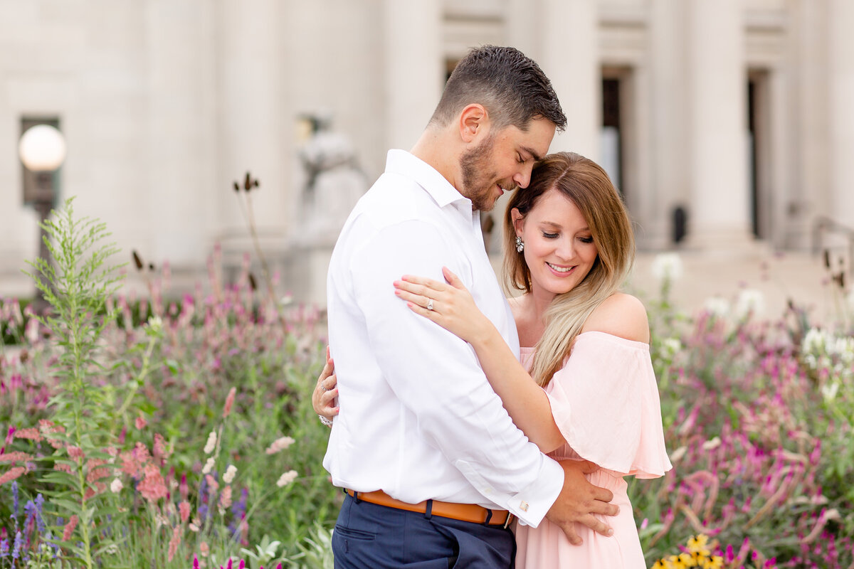 Summer Sunset Engagement Session with pink off the shoulder dress couple by wildflowers at St. Louis Art Museum in Forest Park in St. Louis by Amy Britton Photography Photographer in St. Louis