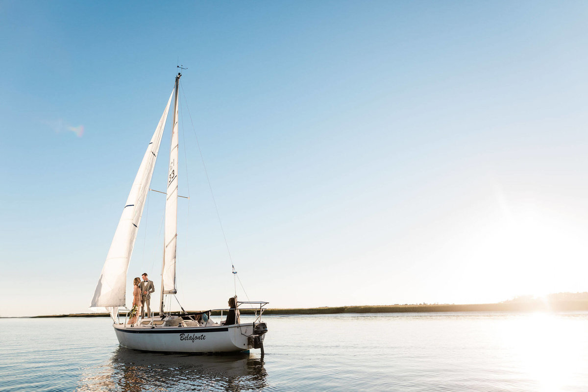 Sunset sailboat wedding by Apt. B Photography