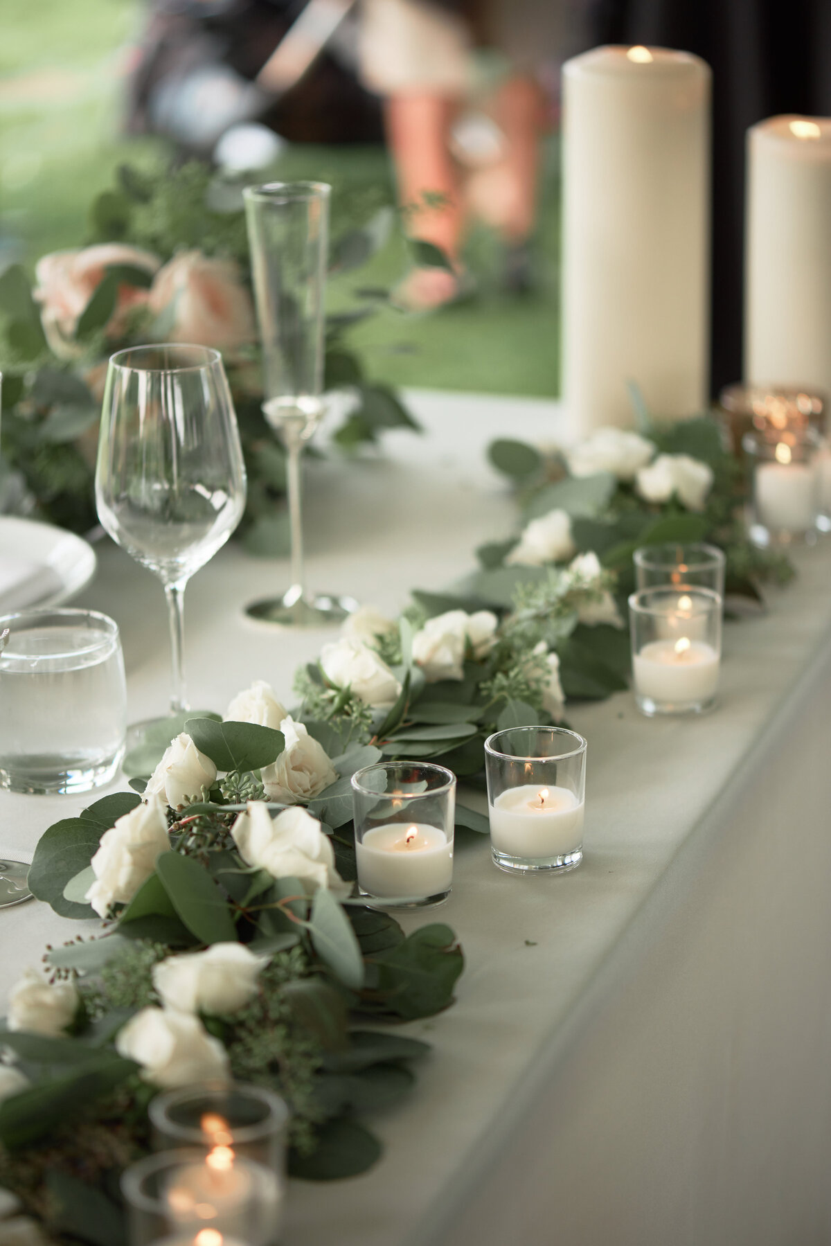 white-blush-greenery-wedding-head-table-candles-decor-25