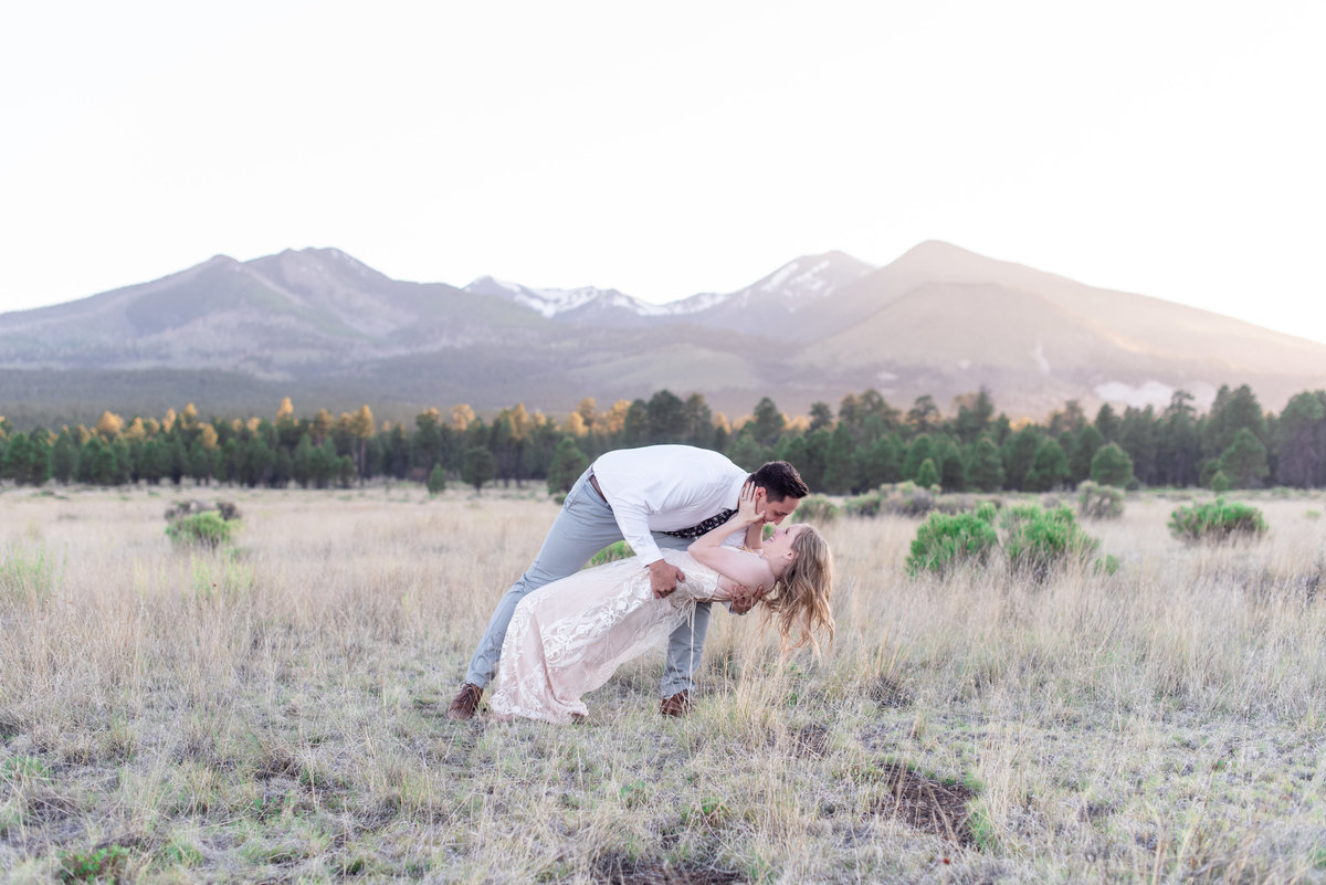 groom dips bride and kisses her in flagstaff arizona