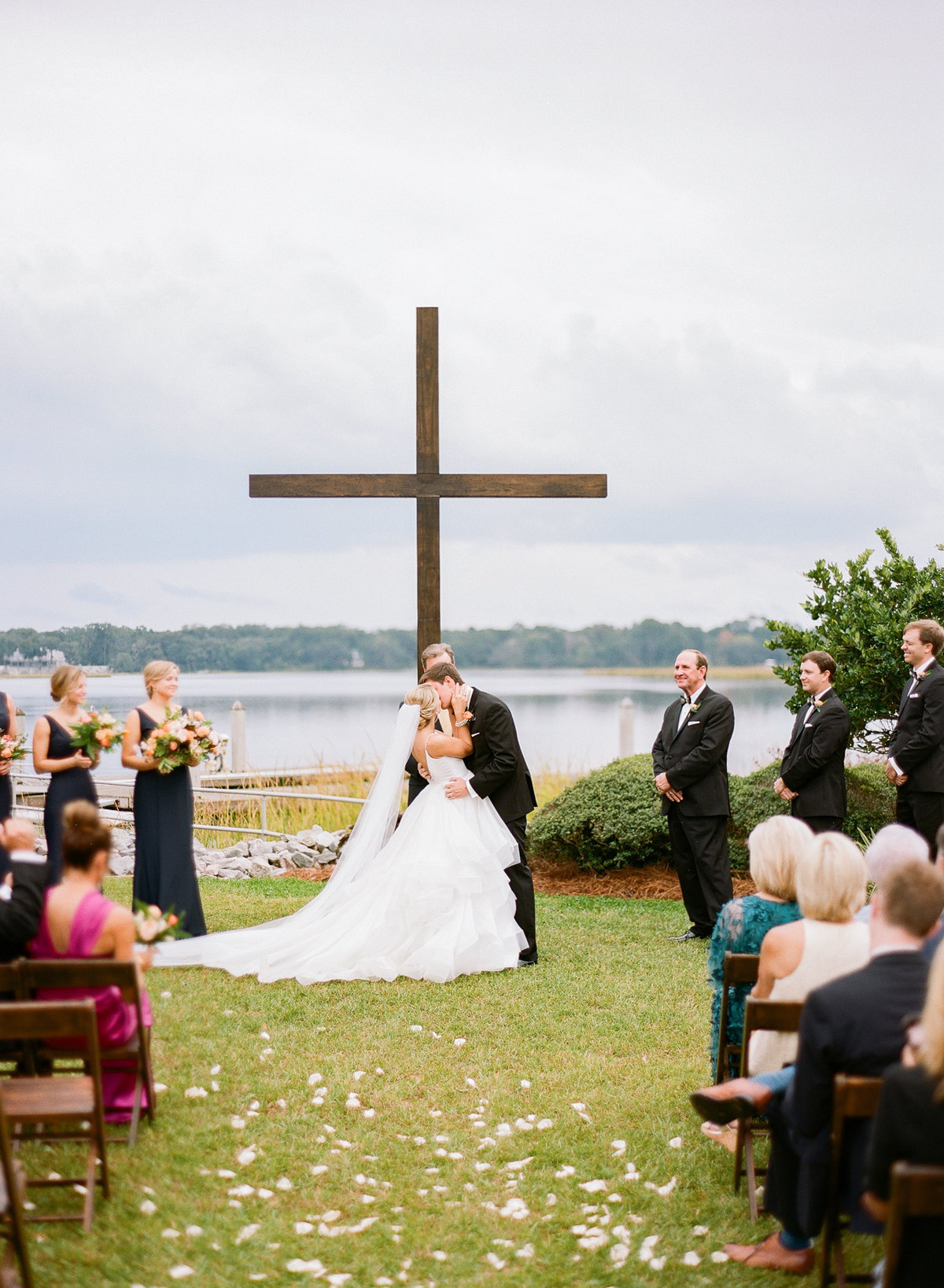 Charleston Wedding Ceremony with Mahogany Cross Waterfront Views Bride and Groom First Kiss
