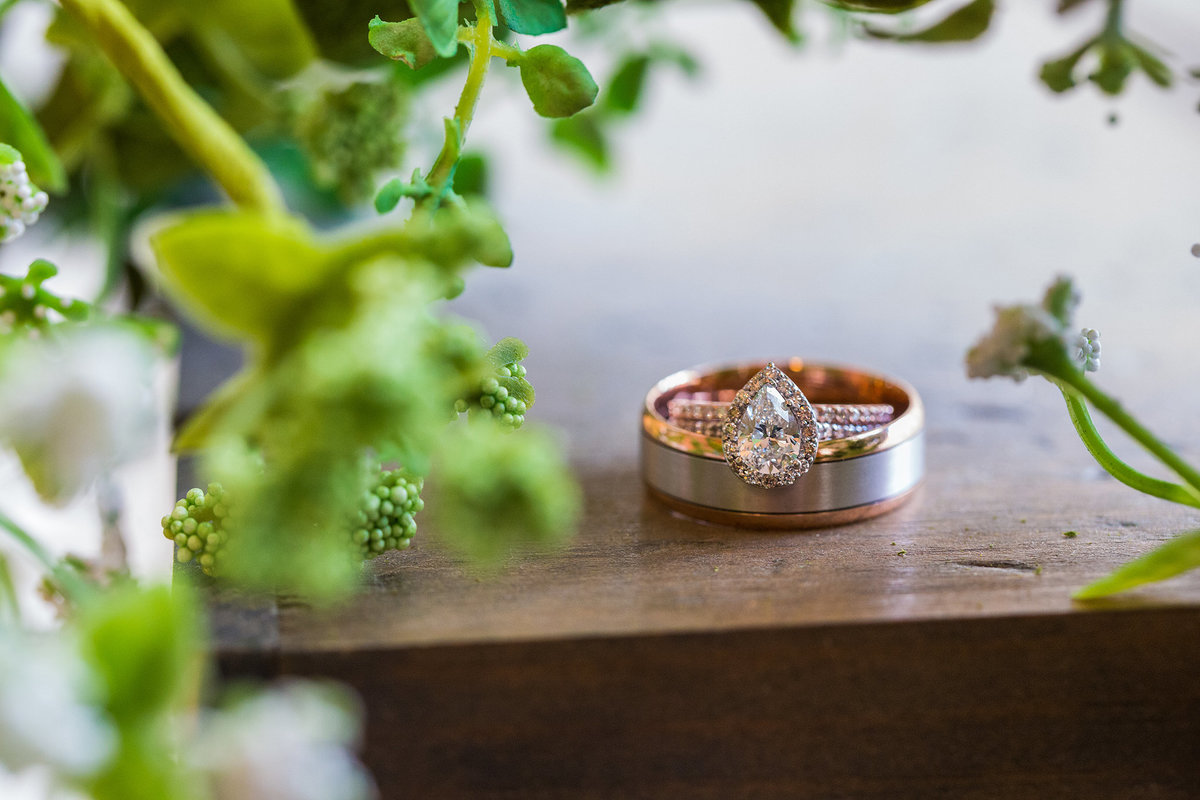 bride and grooms wedding rings in rose gold