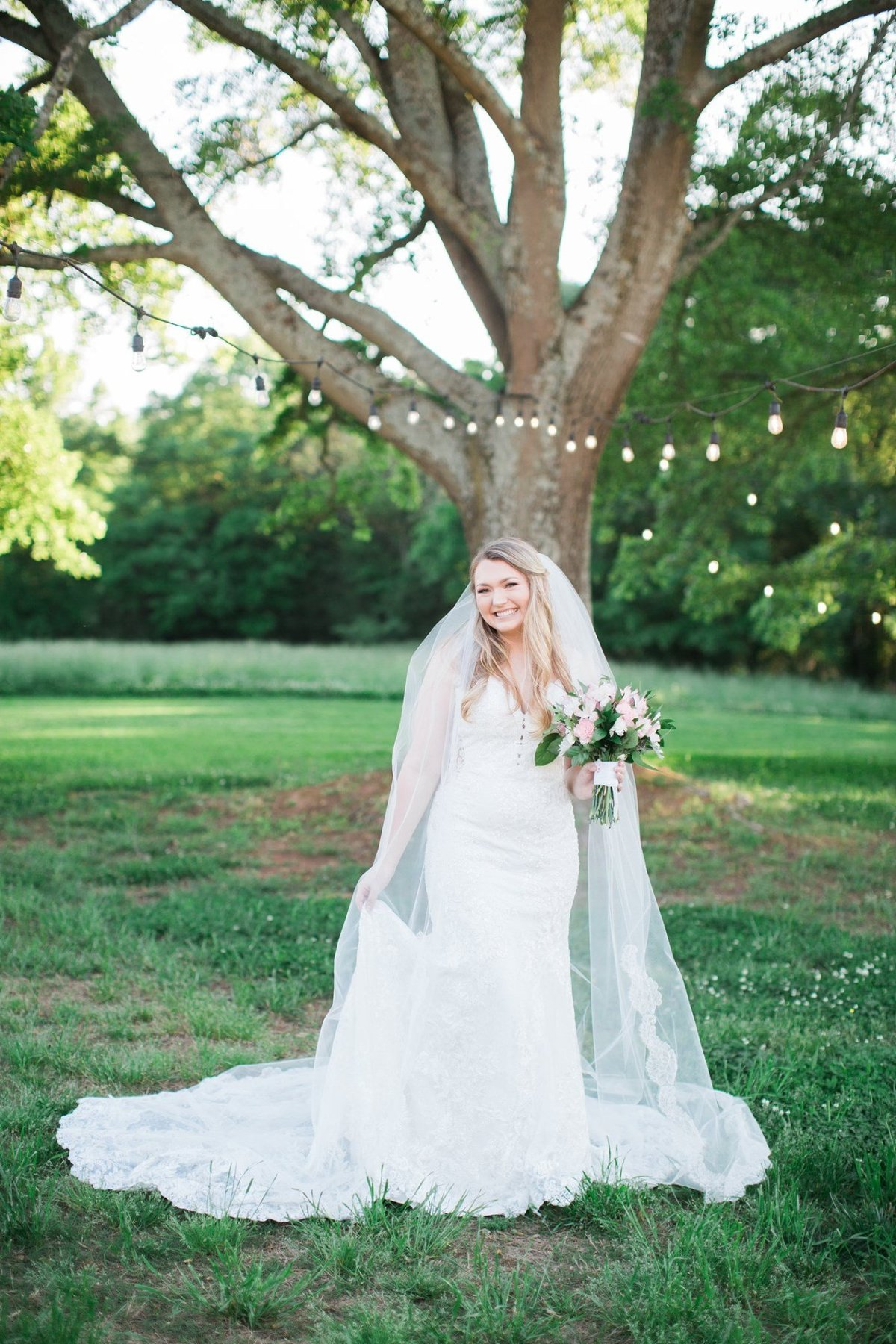 Wedding Photographer, bride standing under a tree