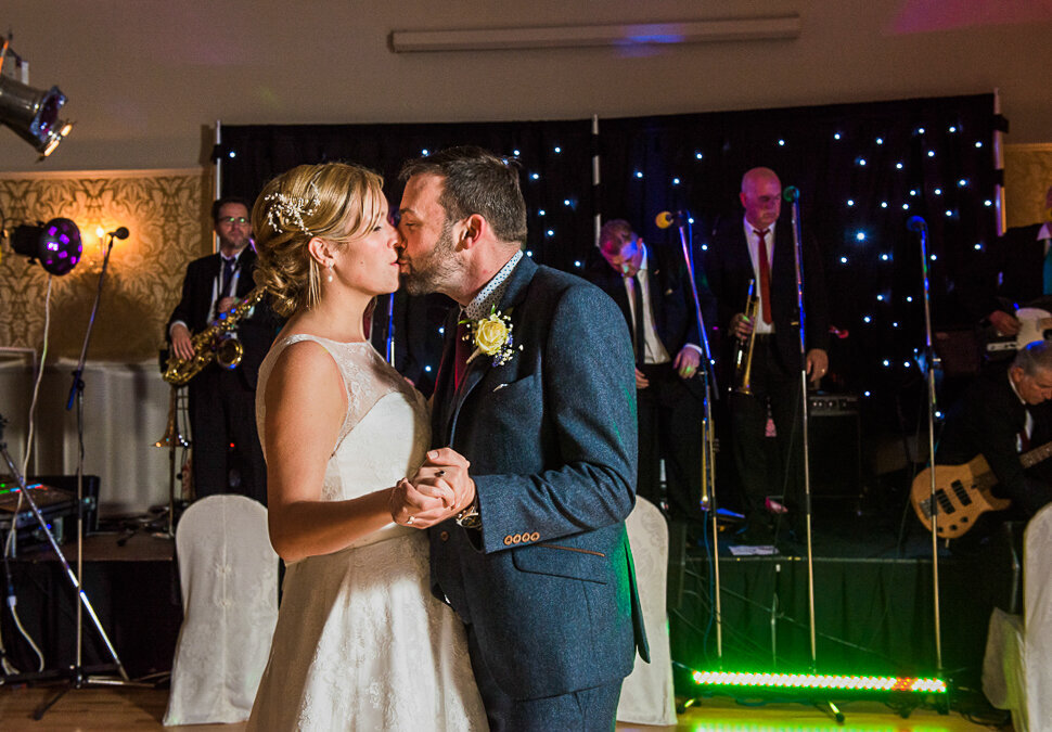 blonde bride kissing groom during first dance at the Dingle Skellig Hotel