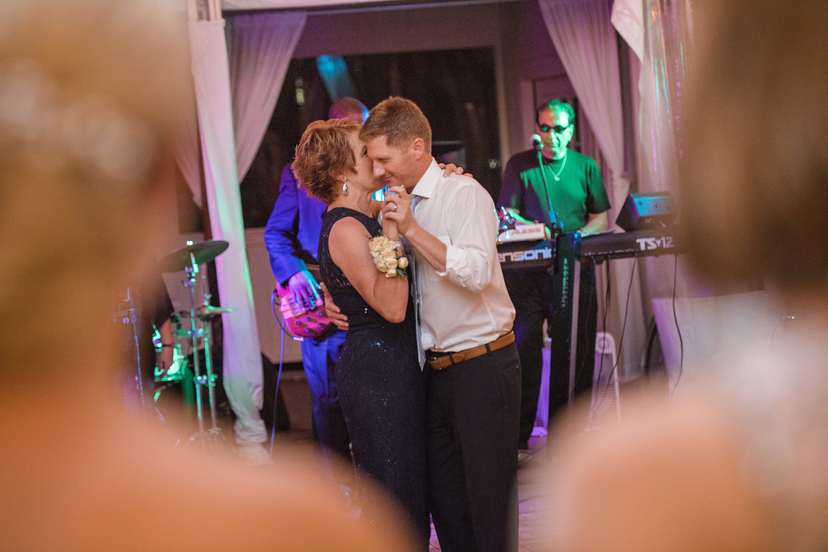 Mother of the groom and groom dancing