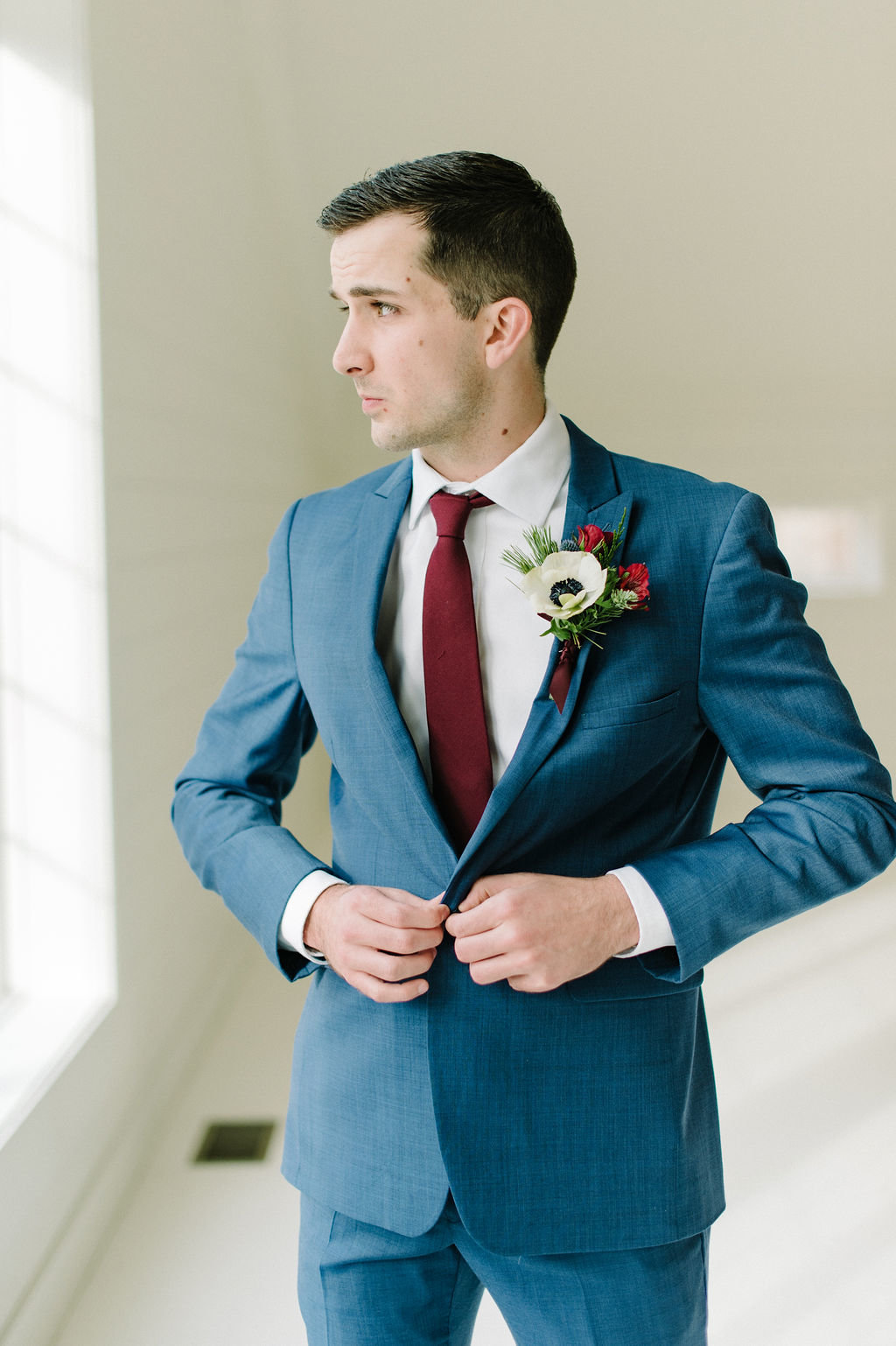 Arkansas groom shows of blue suit / Tyler Rosenthal Photography