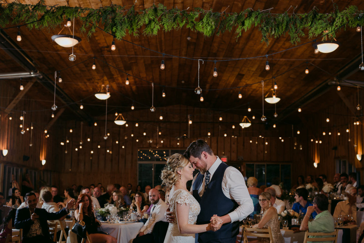 first dance at saunders farm wedding under twinkle lights