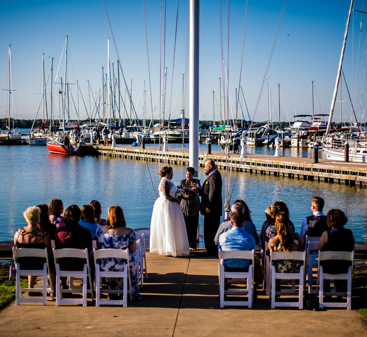 Wedding ceremony held by the flagpole at the Erie Yacht Club