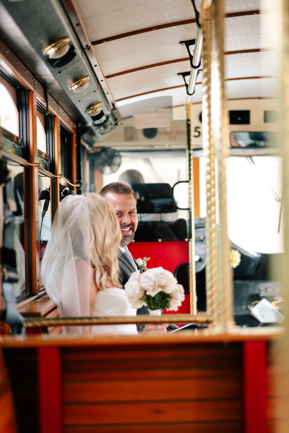 Bride and father on the red trolley at Karma Vineyards in Chelan, WA