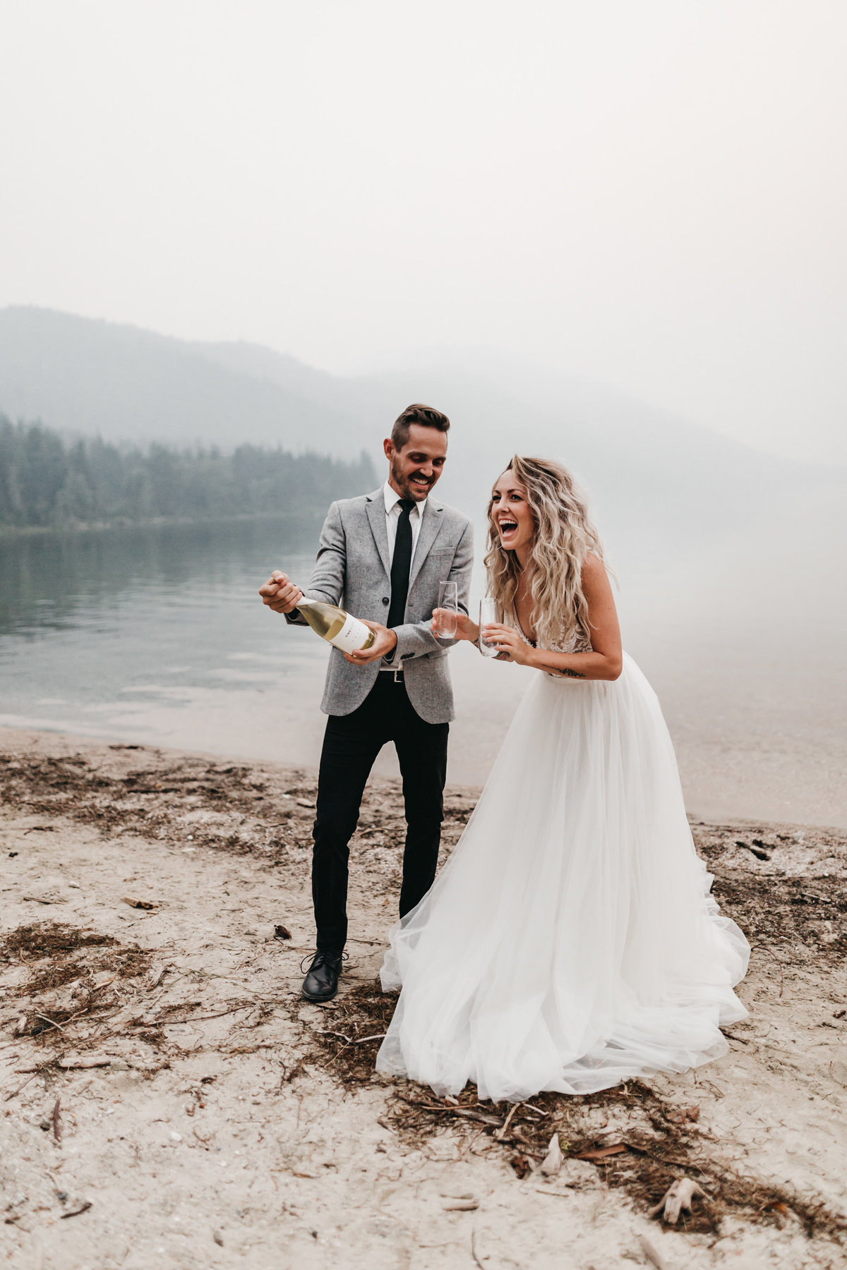 athena-and-camron-sara-truvelle-bridal-wenatchee-elopement-intimate-40-champagne-pop-bride-groom-fun
