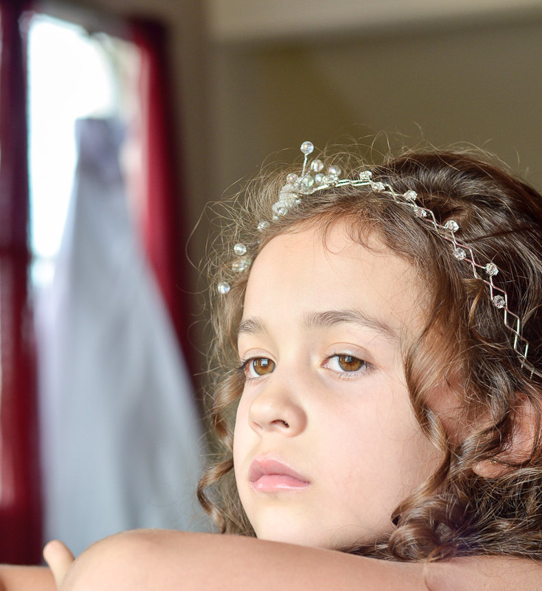 Flower Girl with wedding dress on the background