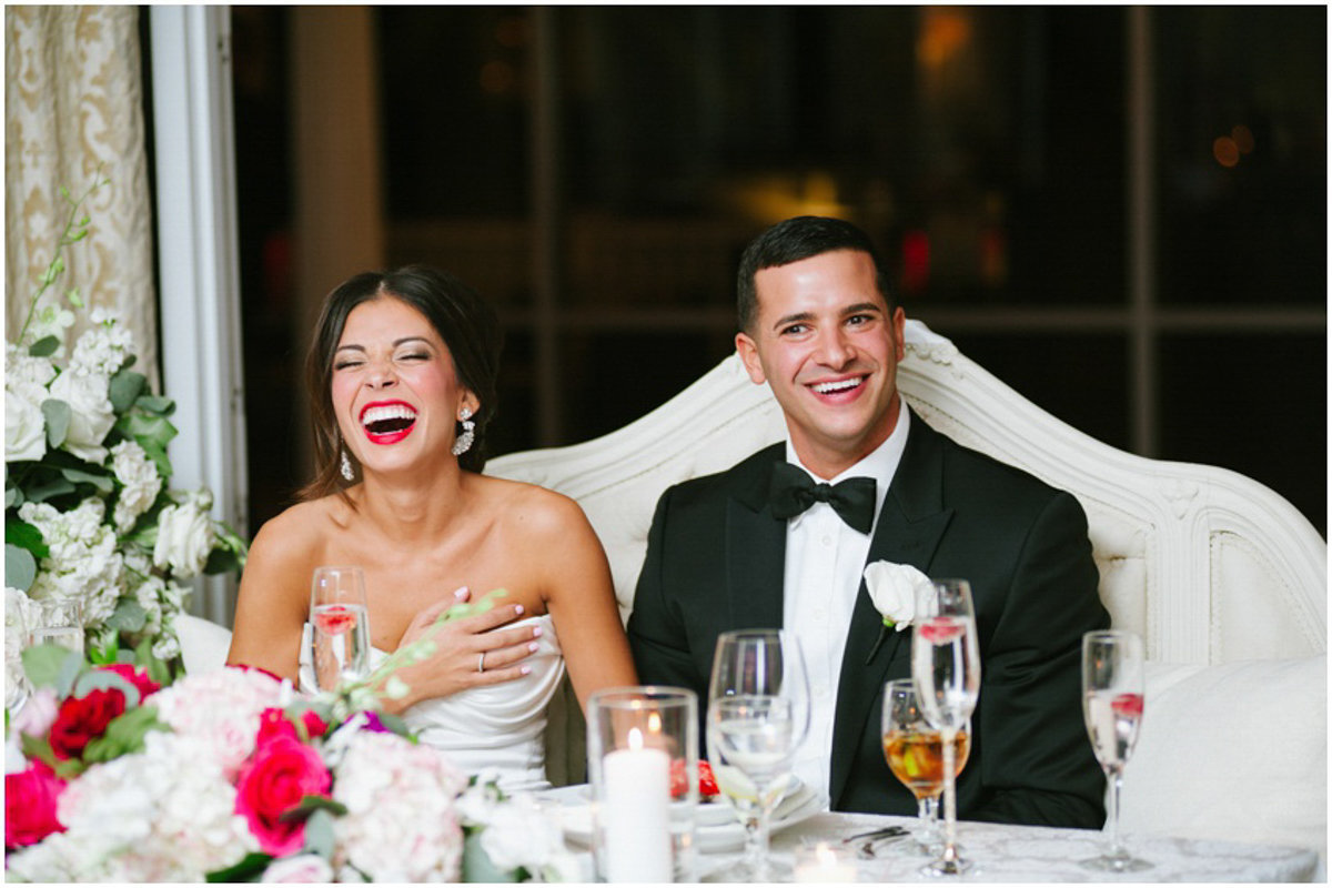 Couple laughing at their wedding toasts at mallard Island