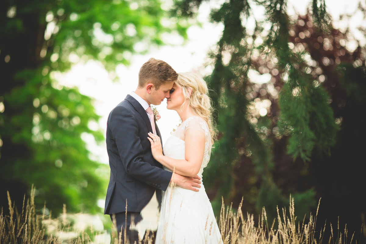 combermere abbey wedding photo in grass