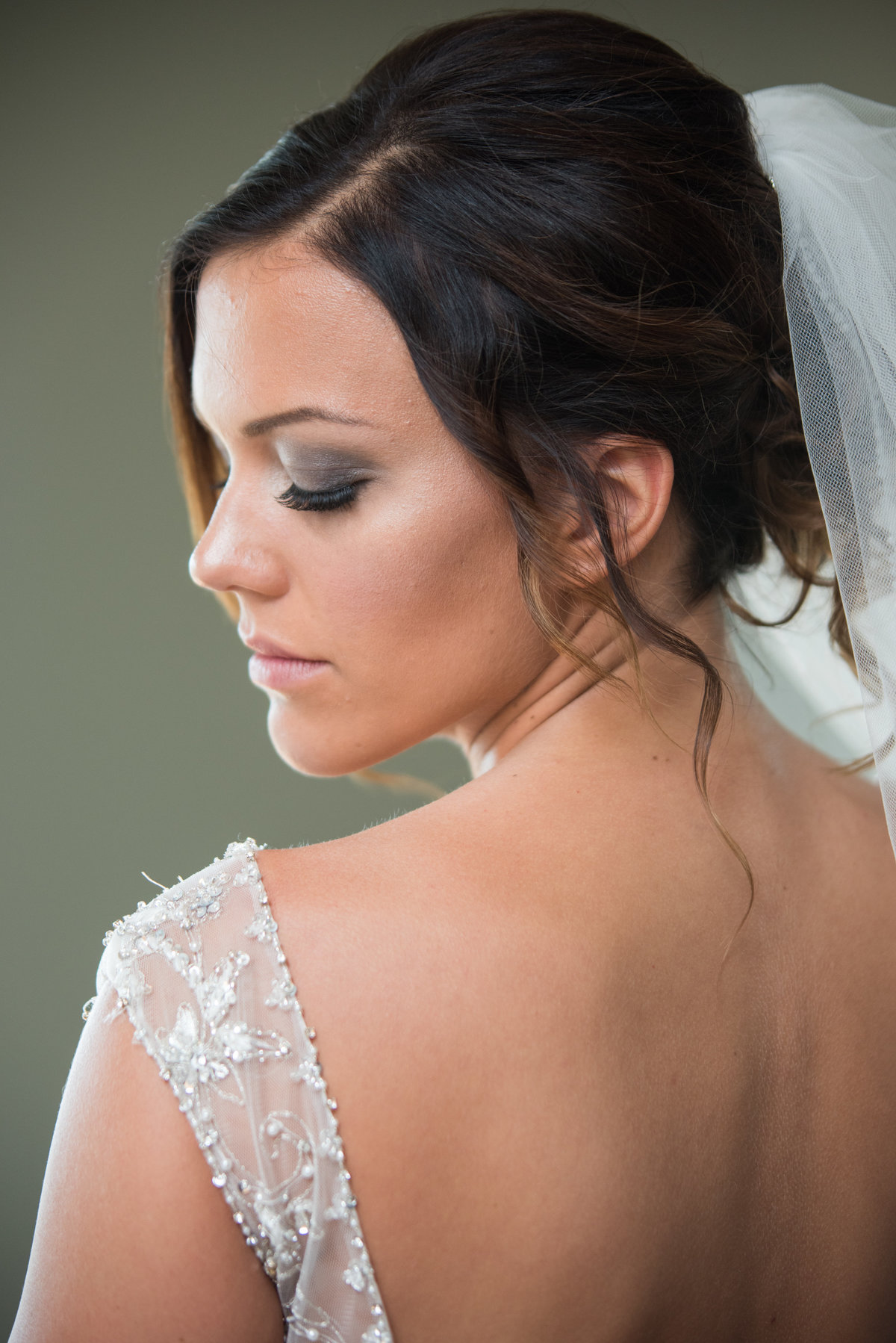 bride in wedding dress looking over left shoulder