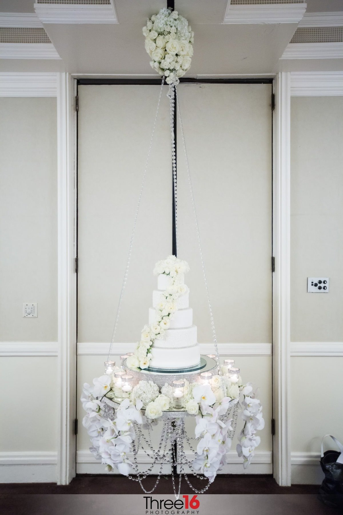 Amazing 5-tiered white wedding cake on display at the wedding reception