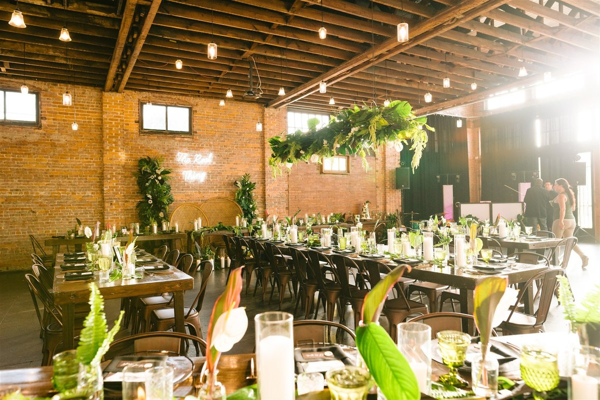 hanging greenery with long tables