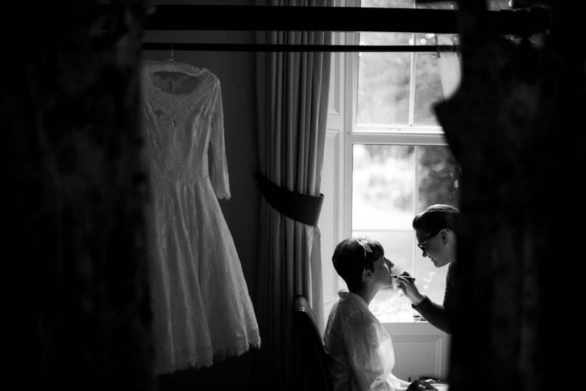 bride getting ready at haselbury mill somerset