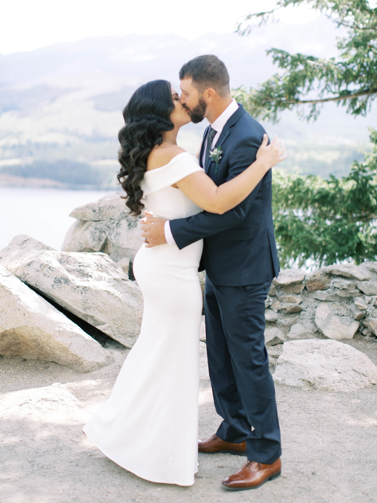 First kiss for bride and groom at their ceremony in Breckenridge, Colorado