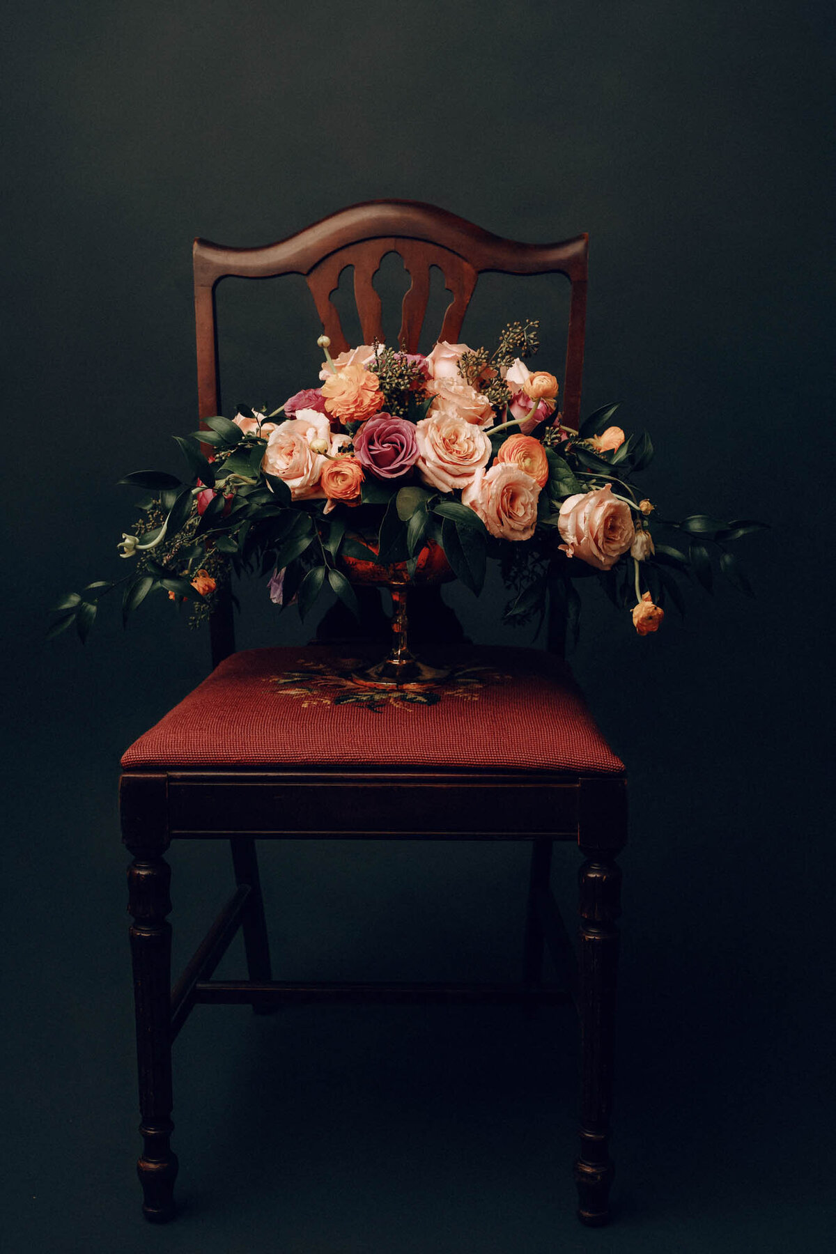 Vase of flowers on an antique chair. Houston, TX.
