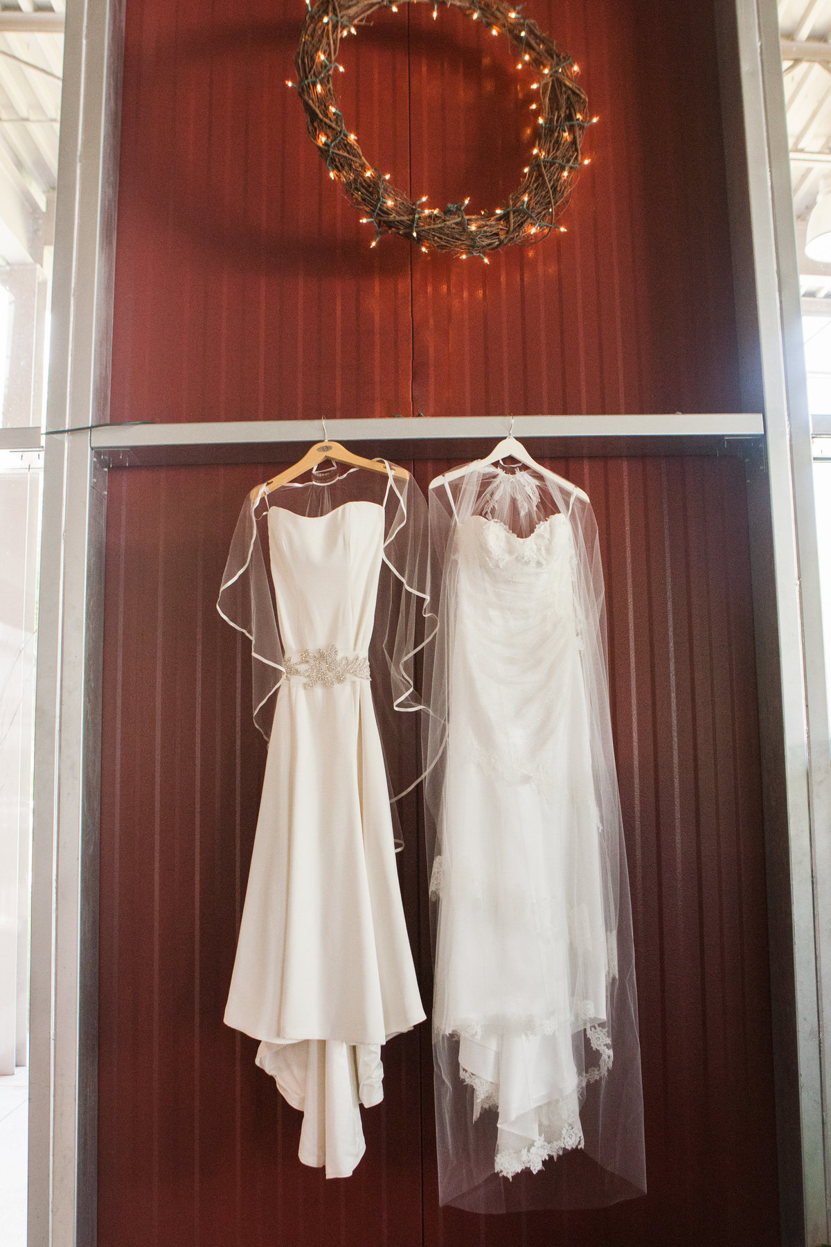 two wedding dresses hanging