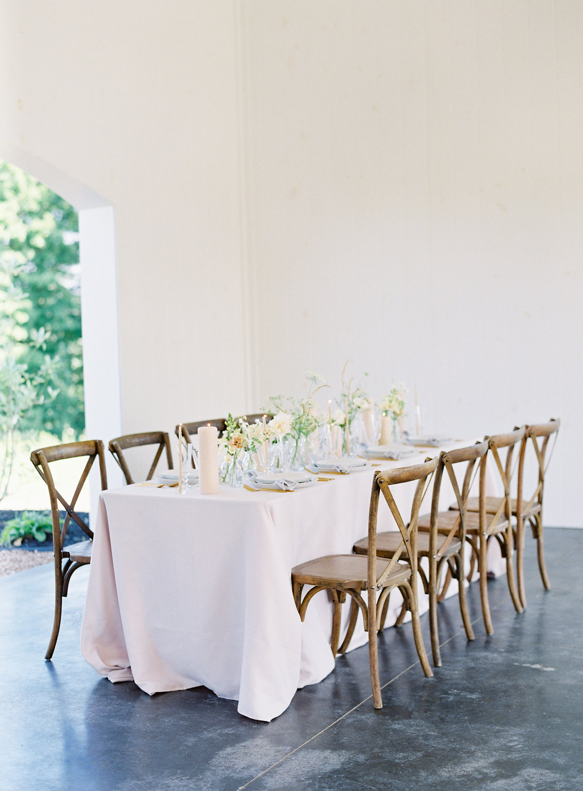 Reception Hall photograph of a table with linens, flowers and candles and wooden chairs Events Held Dear Magnolia Hill Farm | Pittsburgh Wedding Photographer | Anna Laero