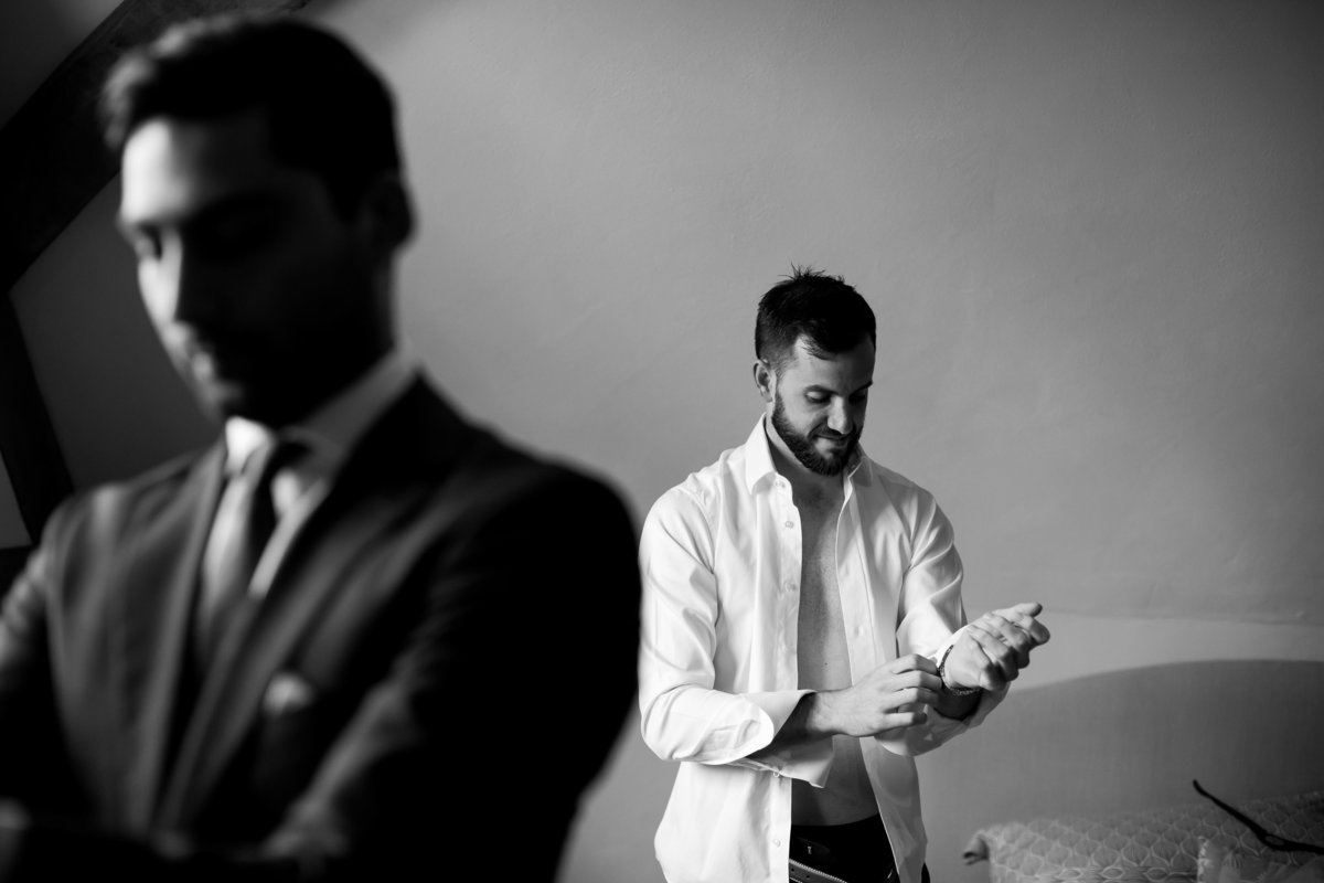 Groom getting ready in black and white at The Oak Barn in Devon