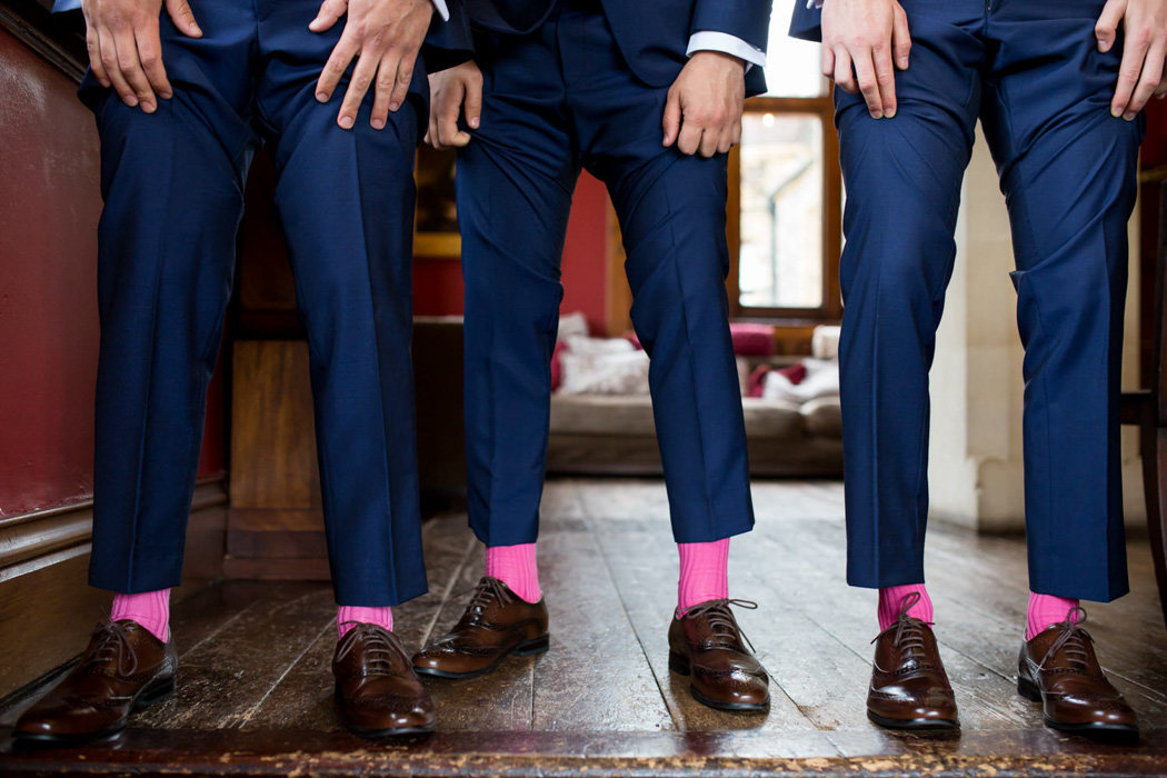 Ushers showing their pink socks at Huntsham Court Wedding Devon