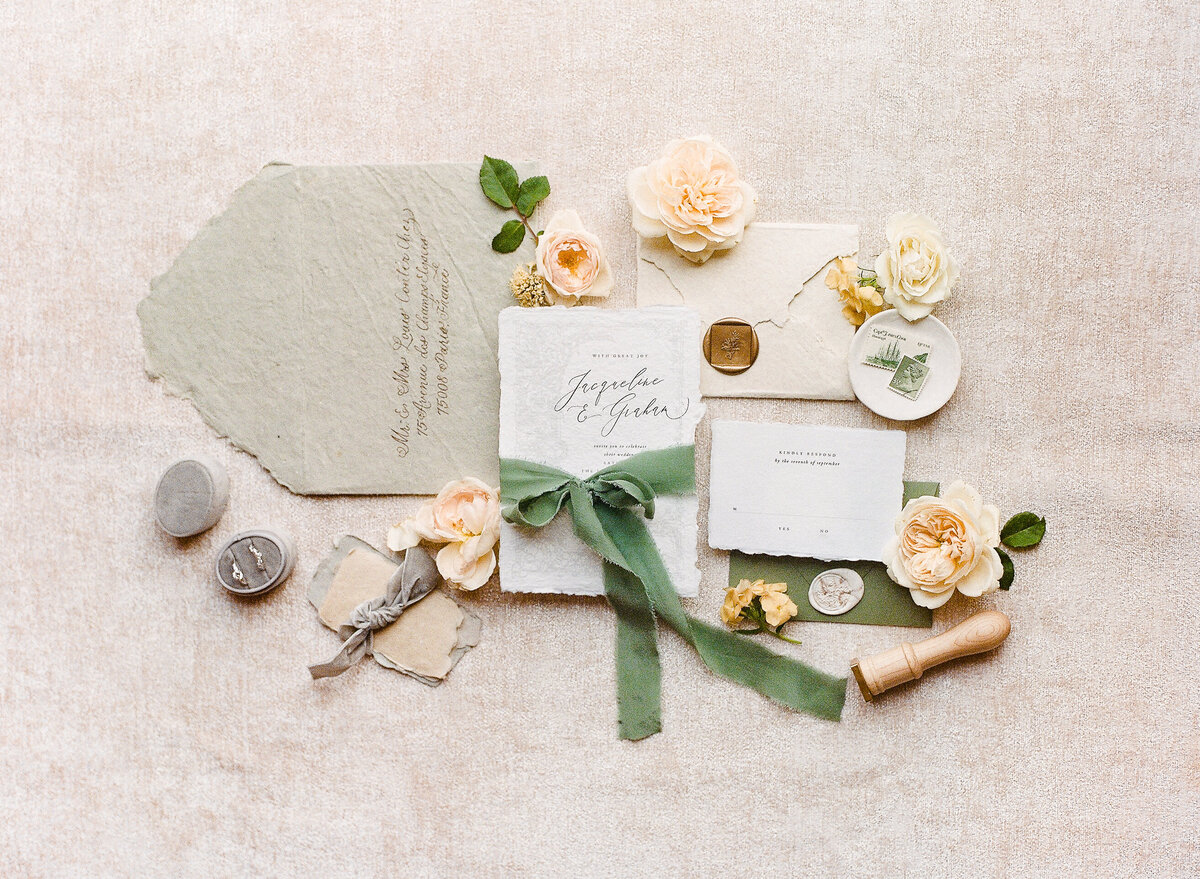 Italian wedding inspired invitation suite with greens and neutrals.