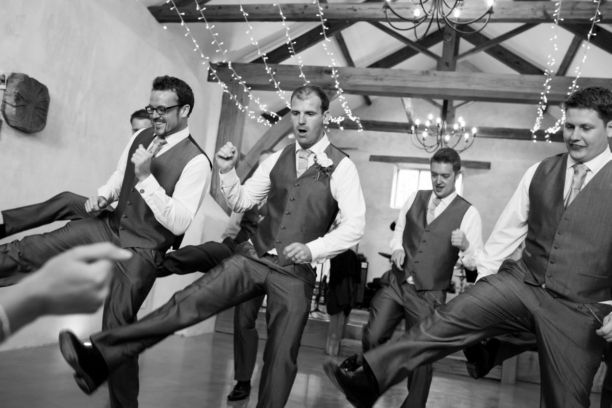 Groom and Groomsmen dancing at Upton Barn in Devon