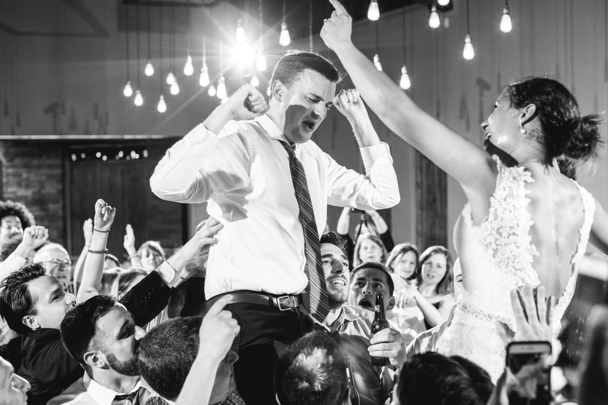 canyonwood ridge wedding photographer bride groom on shoulders reception live band 250 S Canyonwood Dr, Dripping Springs, TX 78620