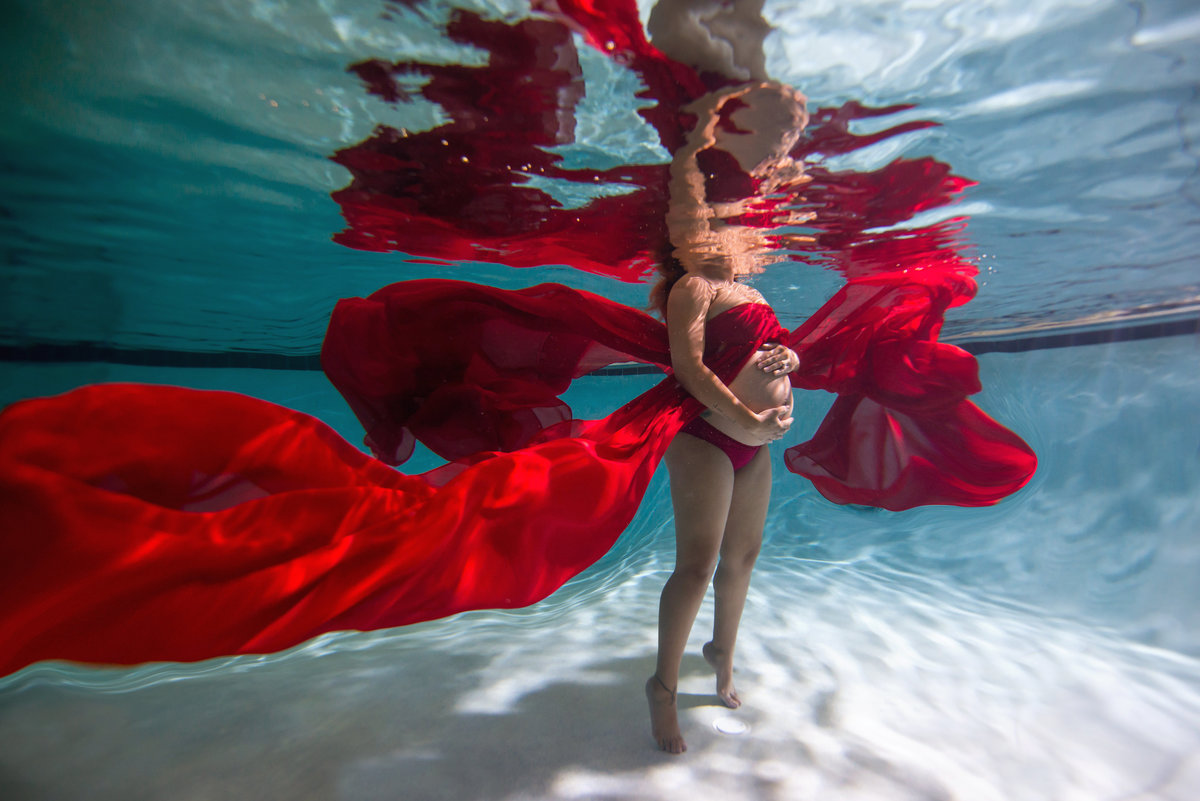 In the water is a beautiful setting for maternity pictures