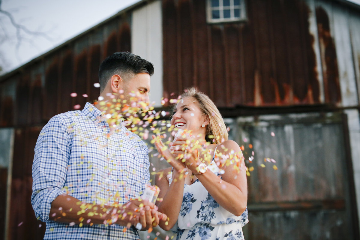 engaged couple pops confetti at laurtia winery