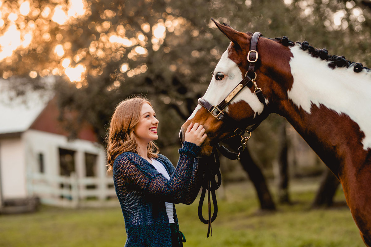 Girl laughing with her horse having fun during her professional photo session in Ocala