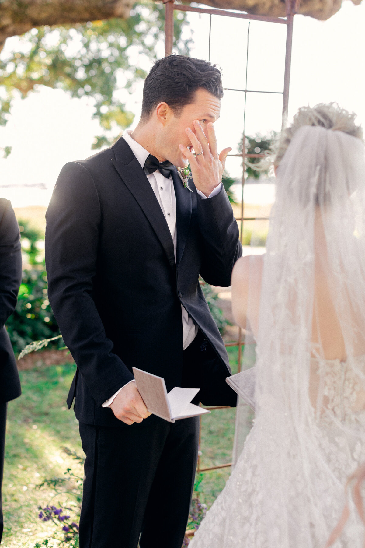 groom crying at altar of outdoor ceremony at Lowndes Grove Charleston wedding