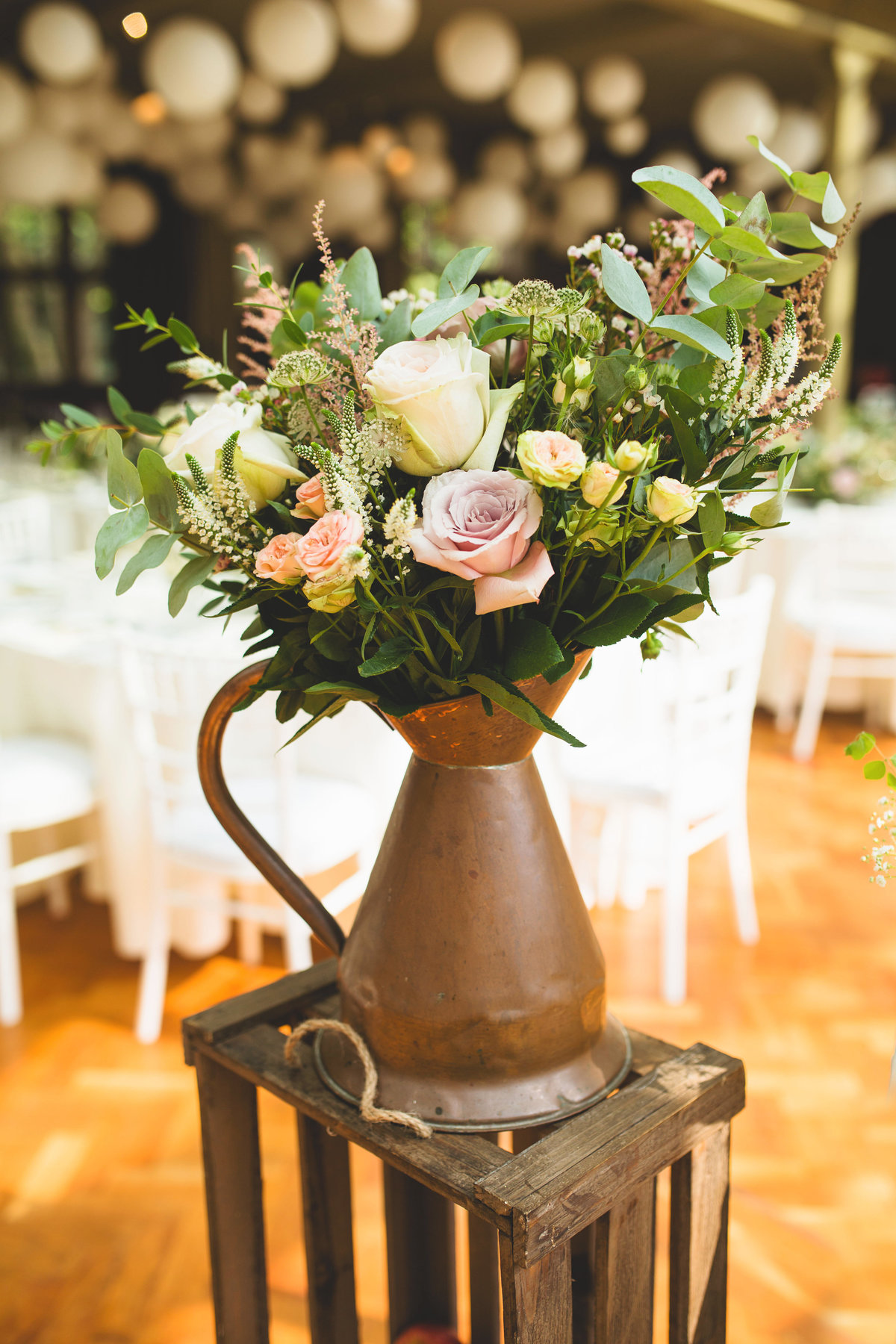flowers at a wedding in a copper watering can