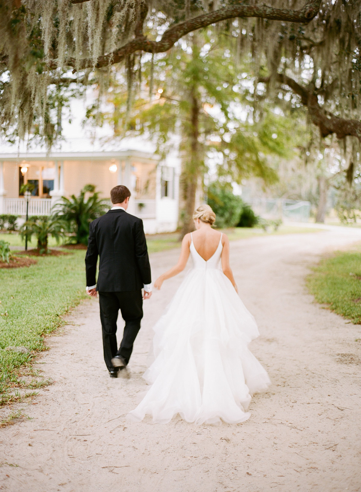 Bride and Groom Newlyweds Walking after Charleston Wedding Ceremony