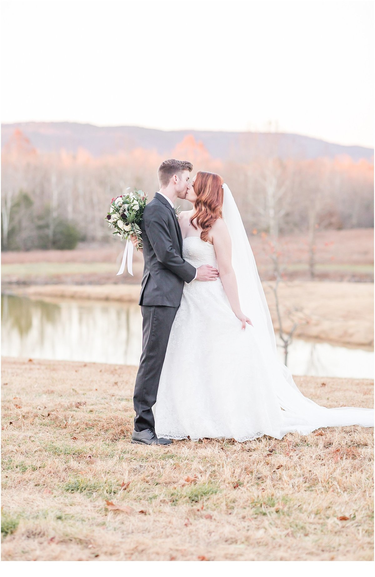 Bride and Groom enjoying romantic kiss  and embrace during their Heritage Acres Farm Wedding Clarksville AR
