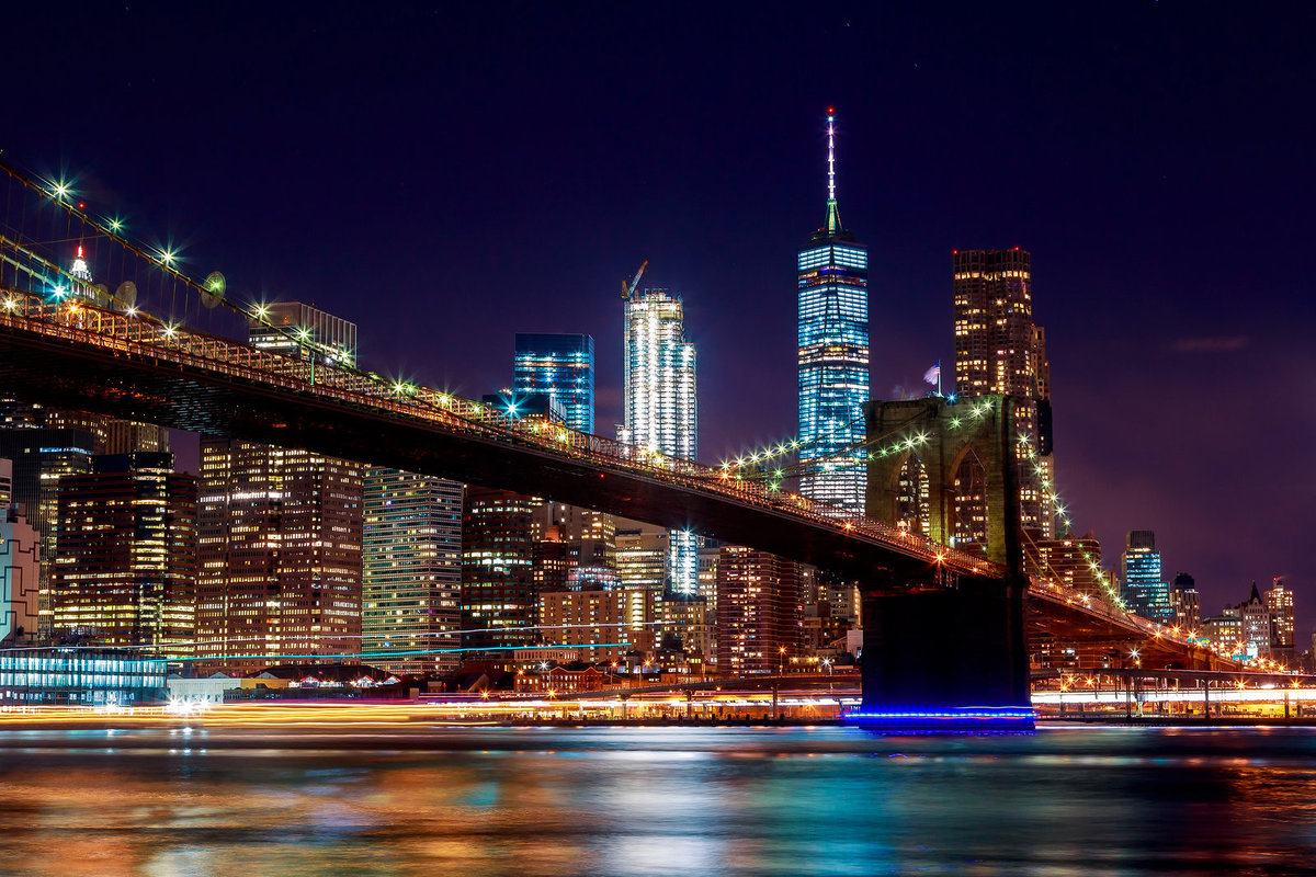 stock photo - nyc skyline brooklyn bridge night blue brown