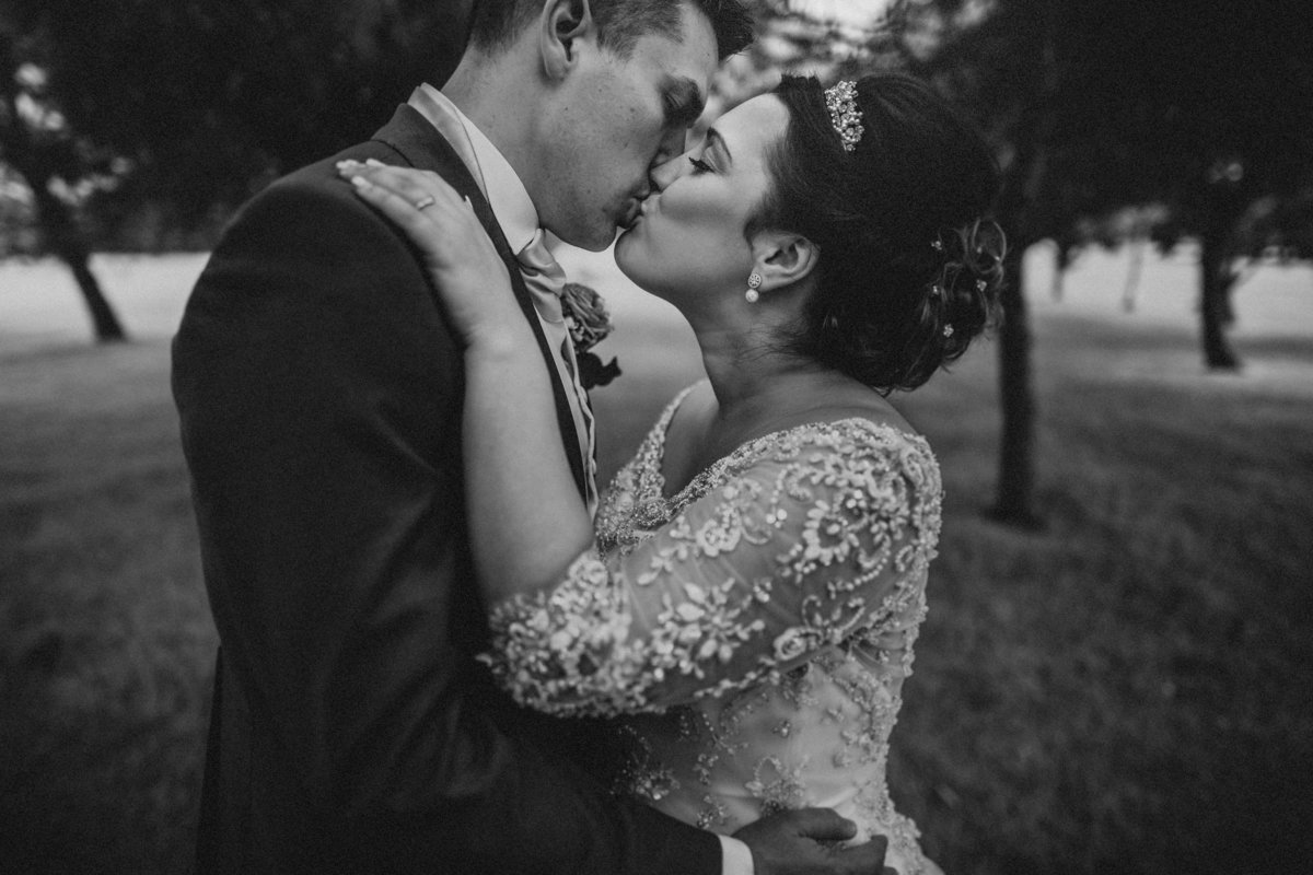 Couple kissing in the grounds of Garstang Golf Club & Hotel - Lancaster Wedding Photography by Jono Symonds