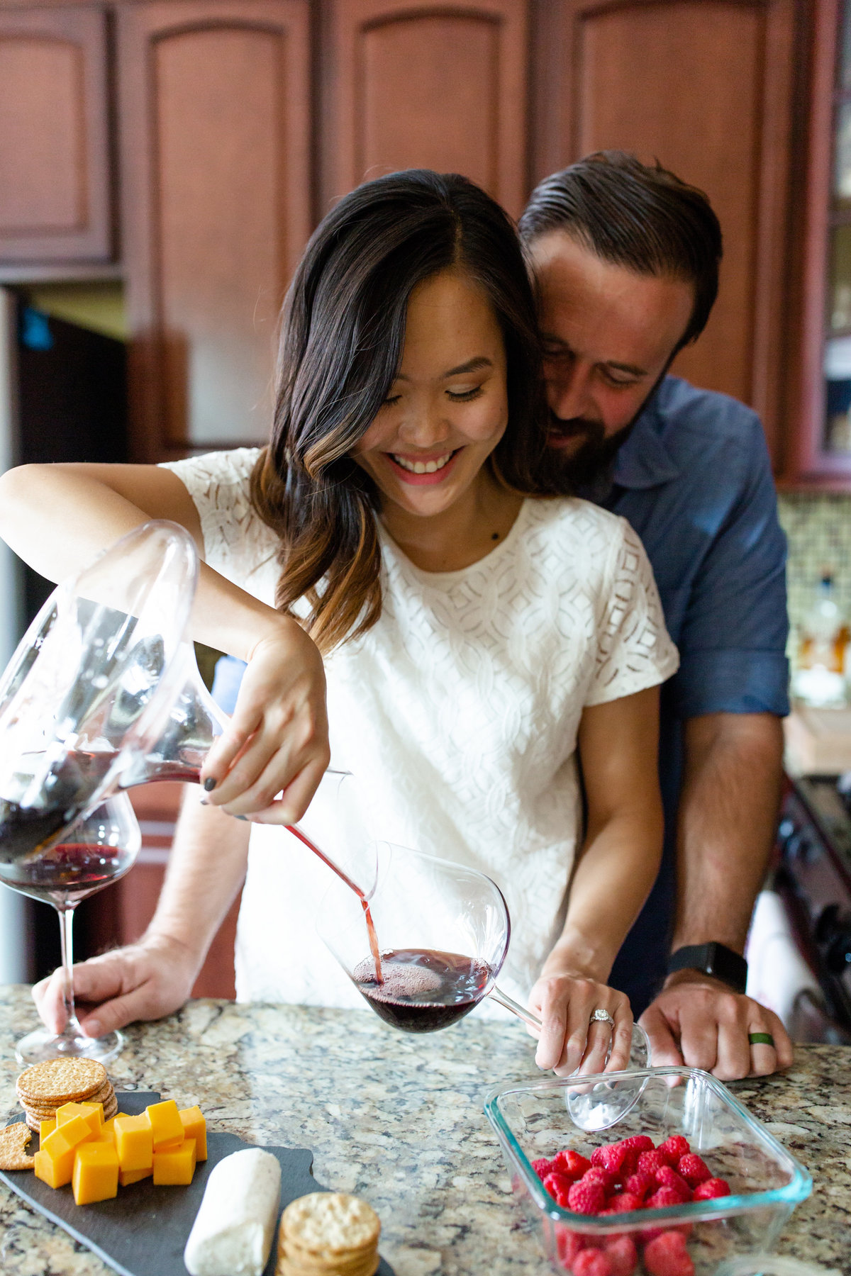 Romantic In Home Lifestyle Couple's  Session pouring wine and cheese plate in kitchen  St. Louis by Amy Britton Photography Photographer  in St. Louis