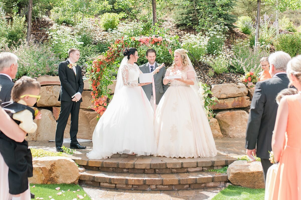 Brides getting married and having a butterfly release at the Hyatt Centric Park City