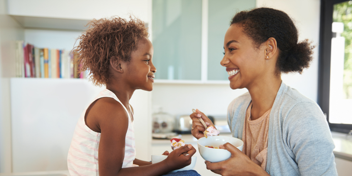 Image Thrive by Spectrum Pediatrics image for home page is a child happily eating with mother during mealtime