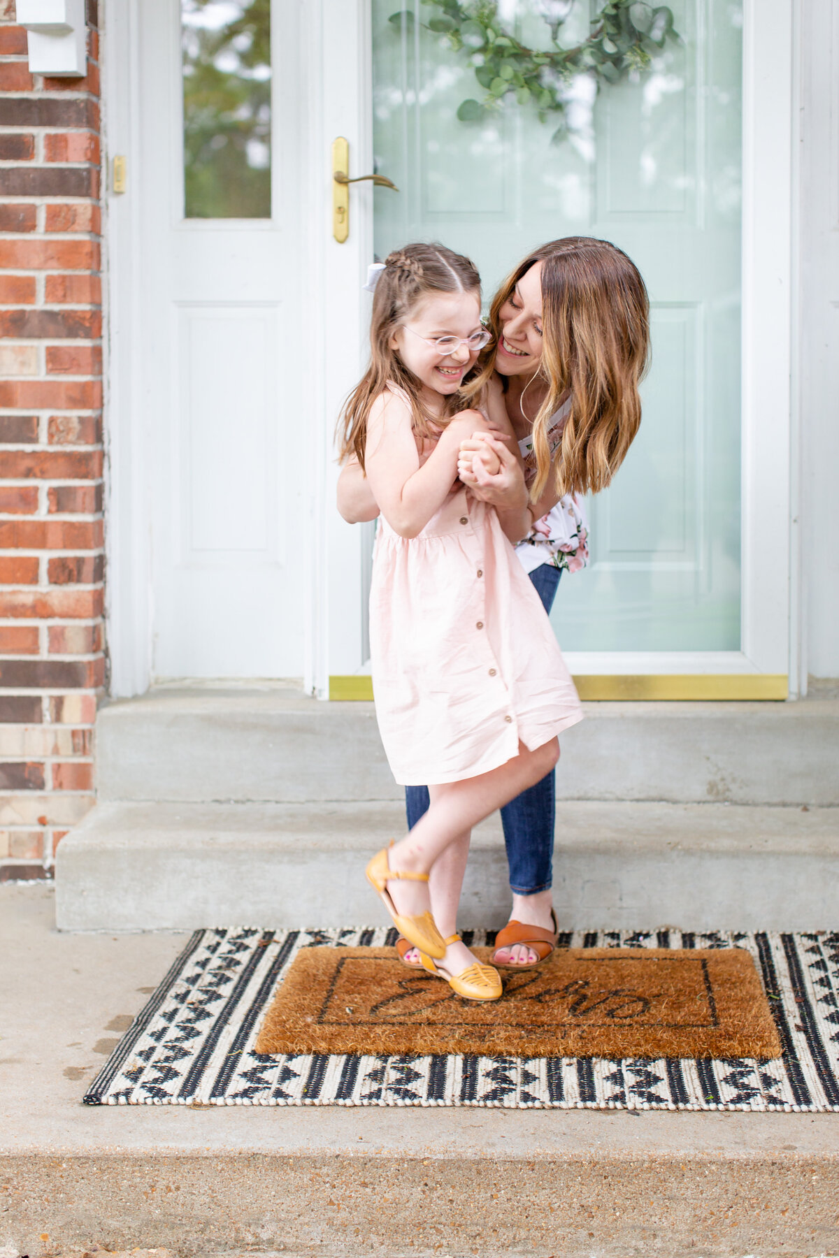 Spring Lifestyle Family  Session mom tickling daughter on front porch  in St. Louis by Amy Britton Photography Photographer  in St. Louis
