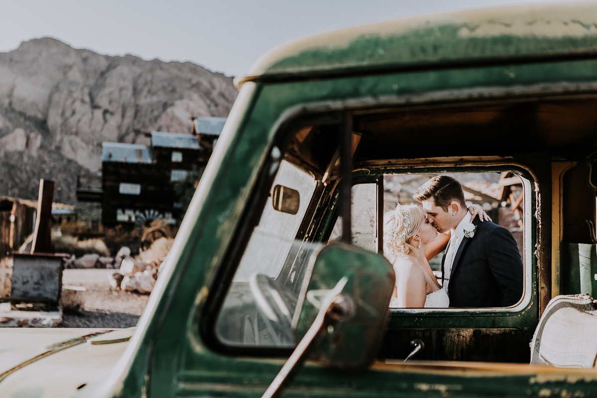 Lake Tahoe wedding photographers couple kisses as seen through car window