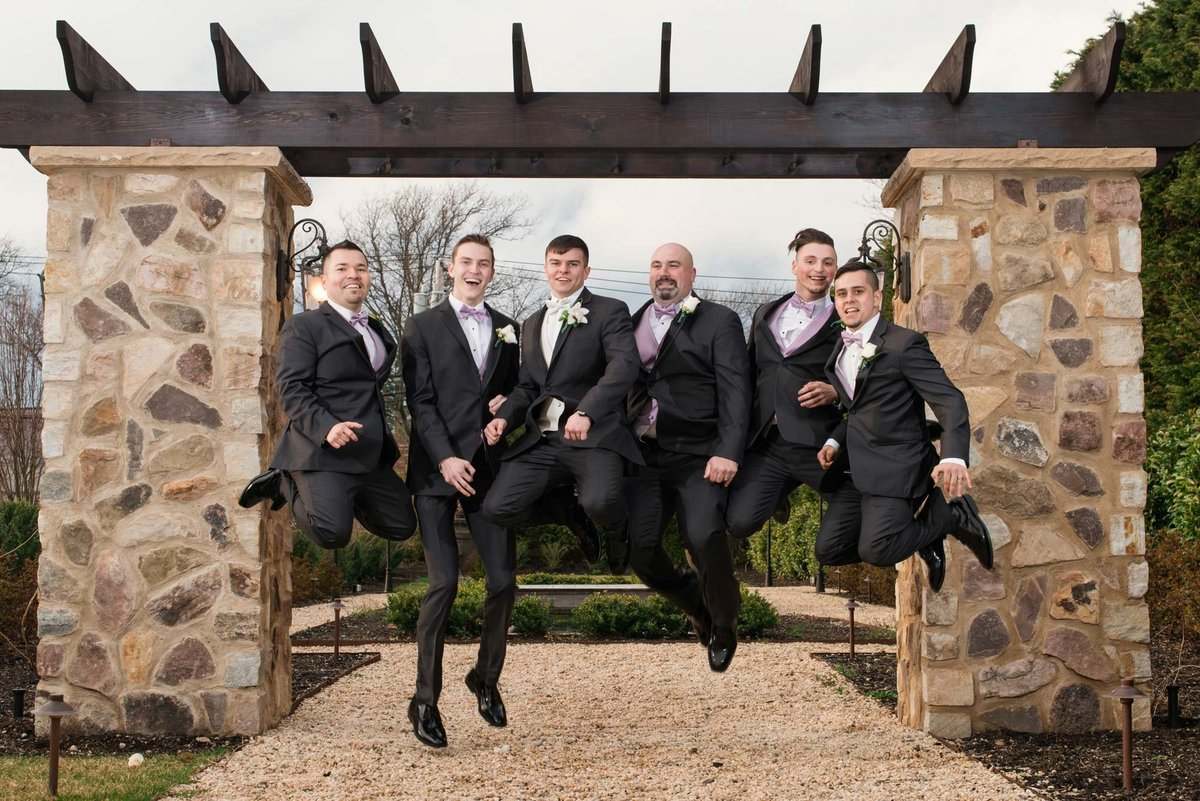 Groomsmen jumping photo