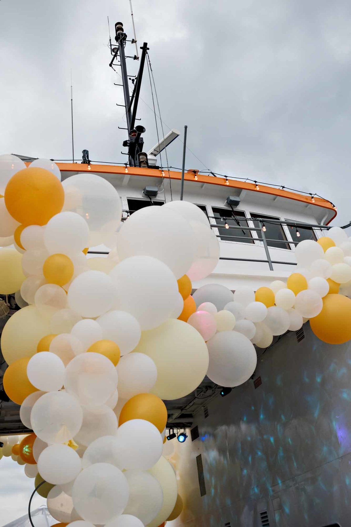 Yellow and white ballon instillation on a boat.