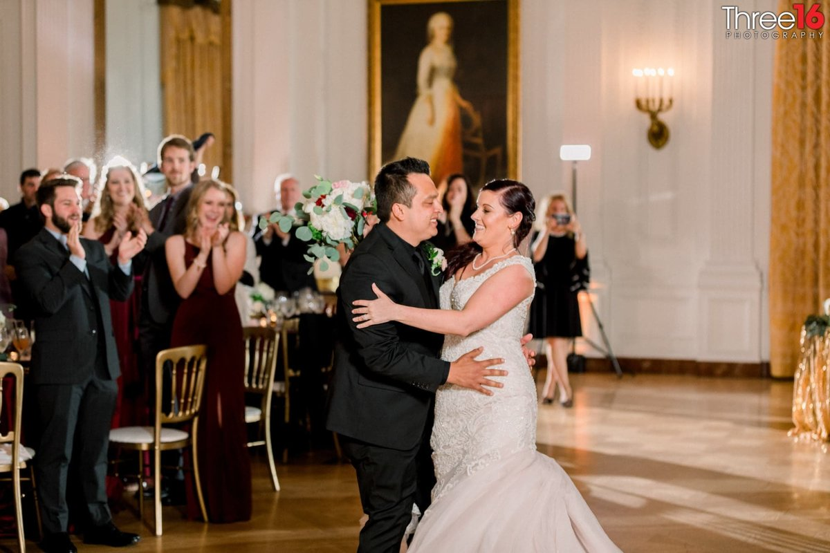 Bride and Grooms First Dance as guests stand and cheer them on