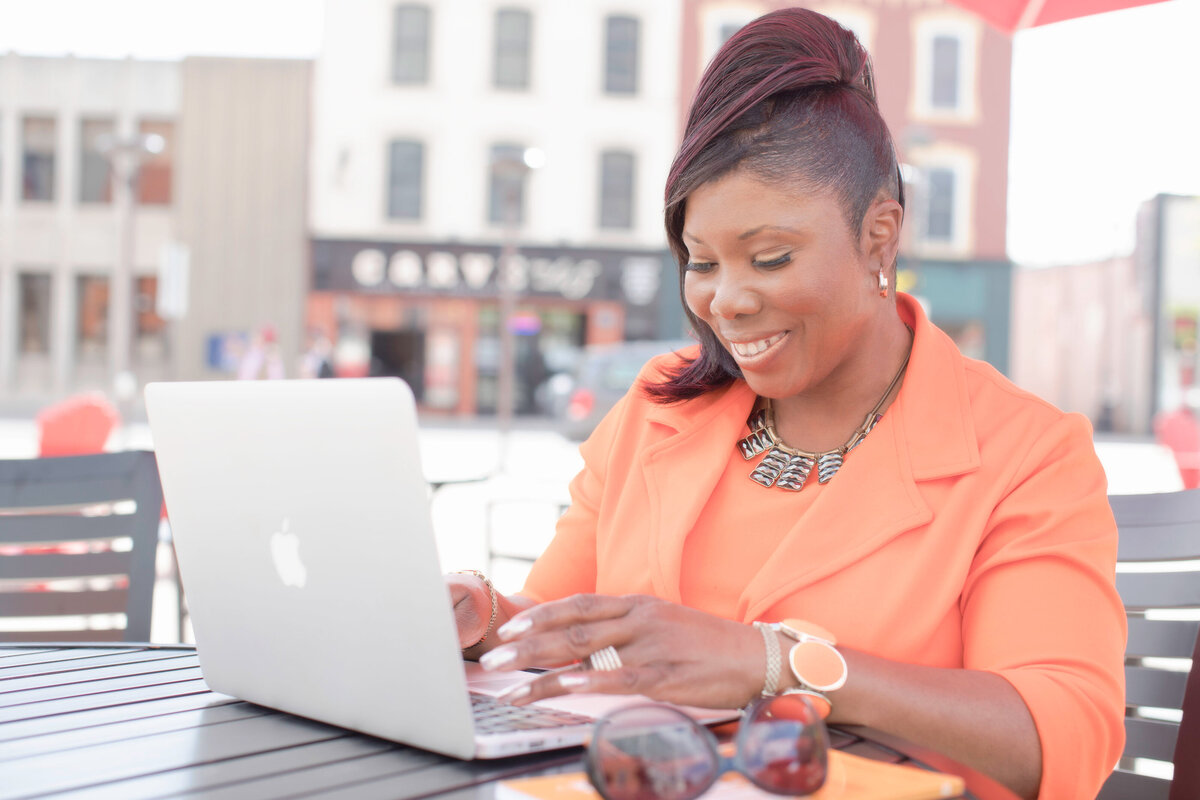 black business woman with laptop